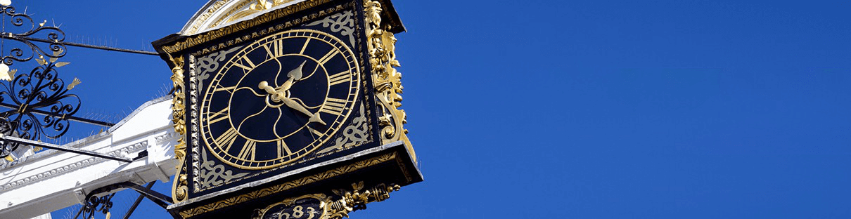 Black & Gold Clock on Building